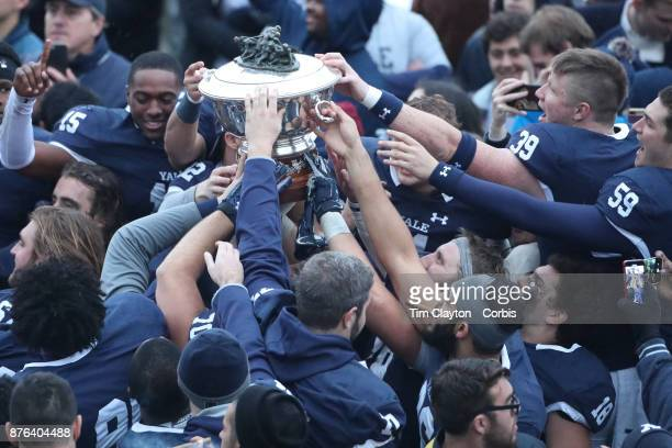 The Yale team with the trophy after the Yale V Harvard Ivy League Football match at the Yale Bowl Yale won the game 243 to win their first outright...