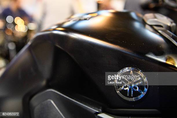 The Yamaha logo is seen on a motorbike at the 'Motorcycle Live' show on November 19 2016 in Birmingham England The show features the latest bikes...