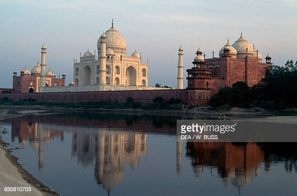 The Yamuna river and the Taj Mahal 16321654 tomb of Mumtaz Mahal wife of the Great Mogul Jahangir with the mosque and the jawab mirror each other at...