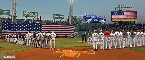 The Yankees and Red Sox lined up for the pre game ceremonies commemorating the 11th anniversary of the 911 terrorist attacks as the Boston Fire...