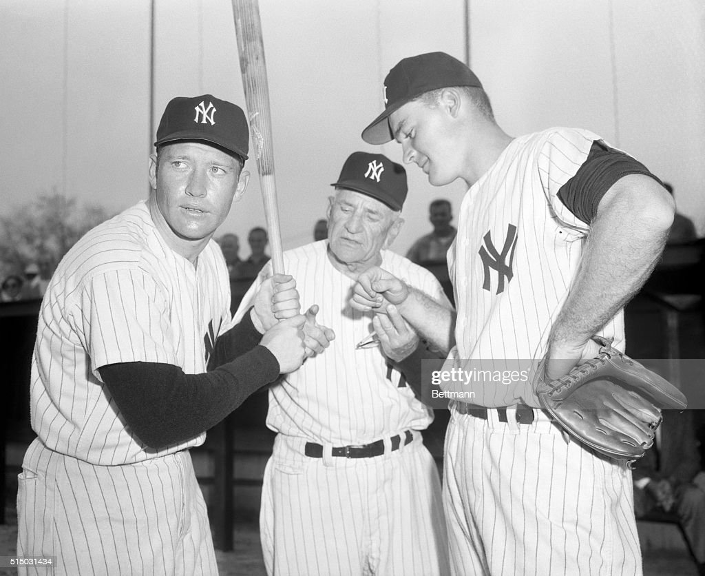 The Yankees' Mickey Mantle holds the bat at left while Yankee manager Casey Stengel gives a bit of grip advice to rookie sensation Deron Johnson (right) at the training camp in St. Petersburg. Johnson has been tagged the rookie most likely to succeed this season.