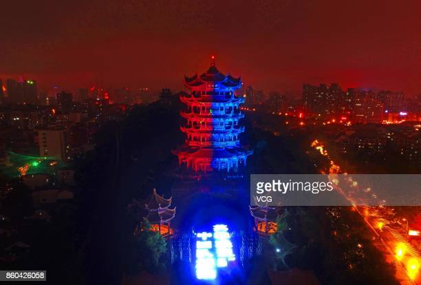 The Yellow Crane Tower is illuminated with red and blue lights for the 2017 League of Legends World Championship on October 11, 2017 in Wuhan, Hubei...