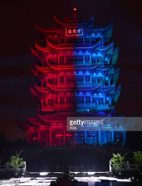 The Yellow Crane Tower is illuminated with red and blue lights for the 2017 League of Legends World Championship on October 11 2017 in Wuhan Hubei...