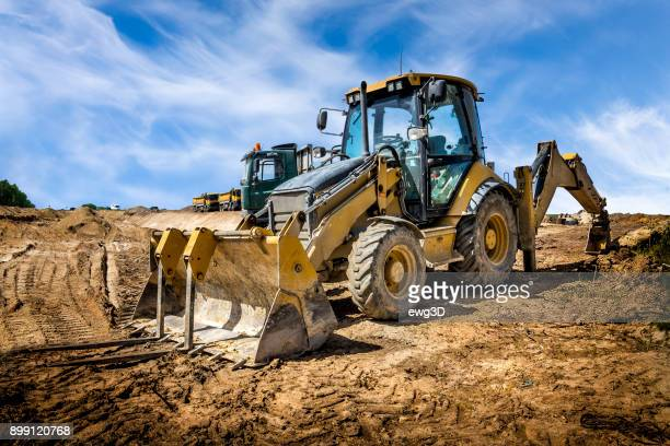 the yellow eart mover on the construction of highway, poland - excavator stock photos and pictures