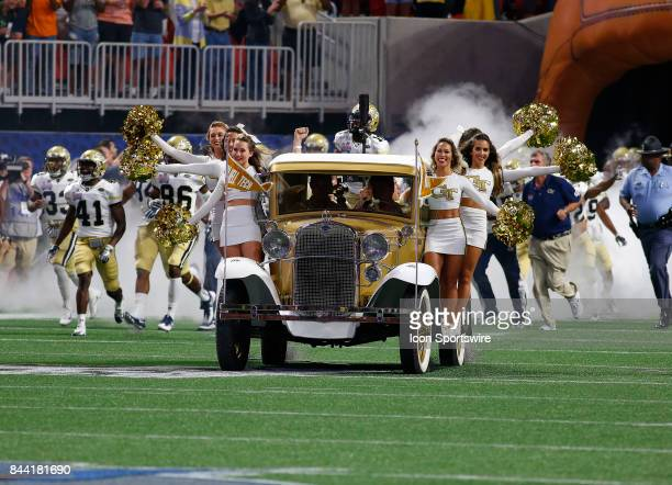 The Yellow Jacket cheerleaders lead the team onto the field prior to the Chic fil A Kickoff Football Game between the Tennessee Volunteers and the...