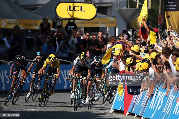 The yellow jersey group sprints toward the finish including Warren Barguil of France riding for GiantAlpecin Geraint Thomas of Great Britain riding...