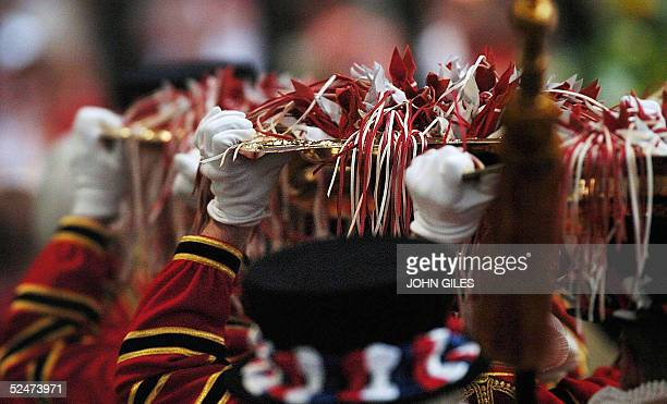 The Yeoman of the Guard carry the Trays of Alms in to Wakefield Cathedral during the Royal Maundy Service 24 March 2005 Britain's Queen Elizabeth II...