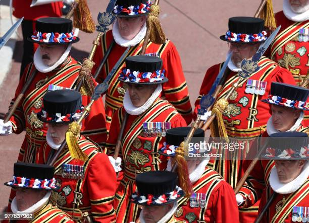 The Yeomen Warders of Her Majesty's Royal Palace march during the Order Of The Garter Service at Windsor Castle on June 18 2018 in Windsor England...
