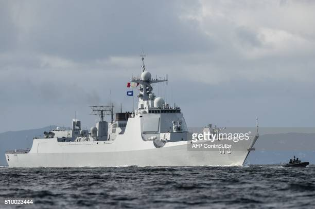 The Yinchuan a Type 052D destroyer of China's People's Liberation Army Navy provides an escort ahead of the Liaoning aircraft carrier into the Lamma...