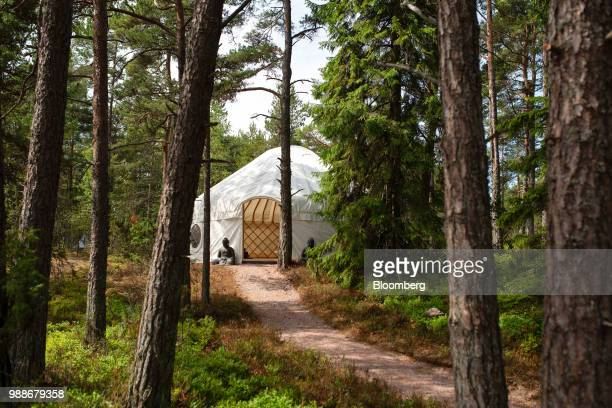 The yoga yurt stands among trees on SuperShe island near Raasepori, Finland, on Wednesday, June 27, 2018. The price of experimental networking on the...