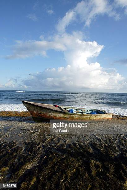 The yola a small boat which carried 12 illegal immigrants from the Dominican Republic sits on the beach April 25 2004 in Aguadilla Puerto Rico A...