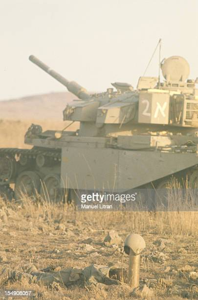 The Yom Kippur War Front of Syria On the Golan Heights a wreck in front of Syrian tank shell casings surmounted the helmet of a dead soldier