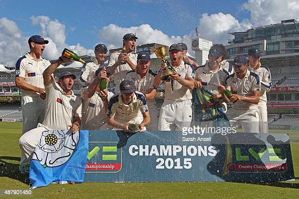 The Yorkshire captain Andrew Gale lifts the Championship trophy aloft as the players spray champagne in celebration after the LV County Championship...