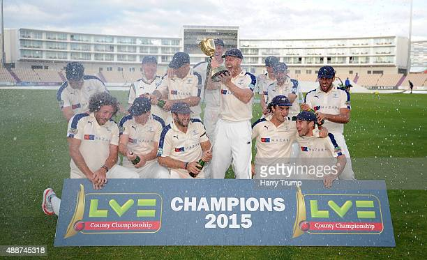 The Yorkshire side pose with the trophy after winning the LV County Championship Division One during the LV County Championship match between...