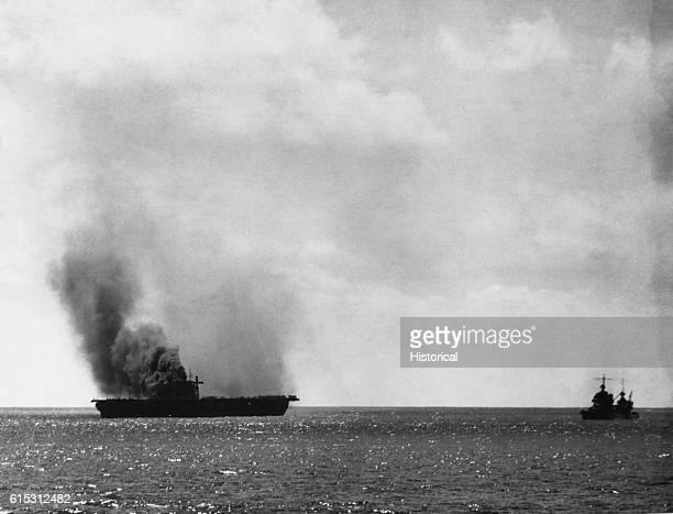 The Yorktown was damaged heavily by Japanese aircraft June 4 1942 in the Battle of Midway Escort ships hover near the damaged carrier which went to...