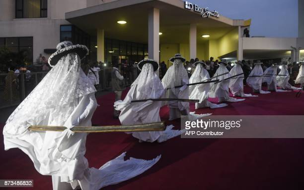 The Yoruba festival dancers known as Eyo masquerades or costumed dancers representing the spirits of the ancestors perform along the red carpet...