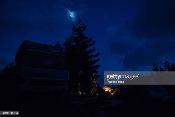 The Yoruks camp at night under the moon in a clouded sky during the nomadic shepherds seasonal migration to the lower grazes on coastal hills
