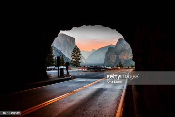 the yosemite tunnel view from inside tunnel road during sunset. - yosemite nationalpark foto e immagini stock