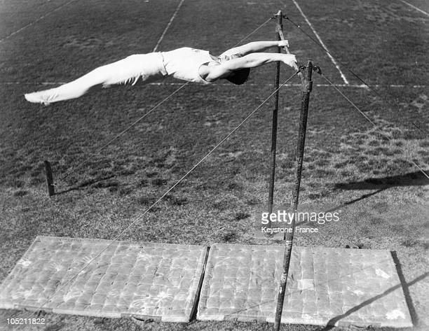 The Young American Gymnast Jack Holst Demonstrates A Remarkable Technique To The Fixed Bar At The Athletic Club In Los Angeles June 9 1933