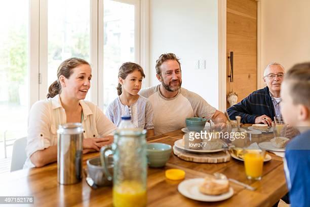The young Australian family enjoying breakfast