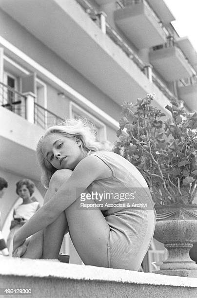 The young British actress Jill Haworth sitting on a fence during a break on the set of the film Exodus Cyprus 1960