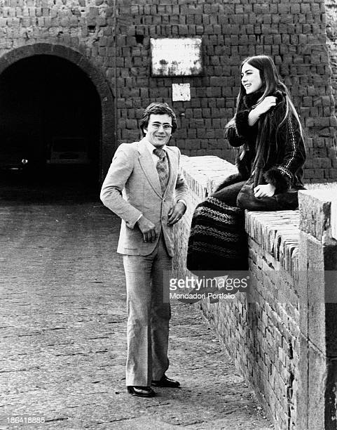 The young couple of artists Al Bano born Albano Carrisi and Romina Power in front of the entrance gate of Castel dell'Ovo an ancient castle located...