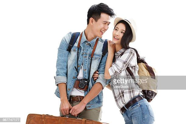 The young couple took the luggage to travel
