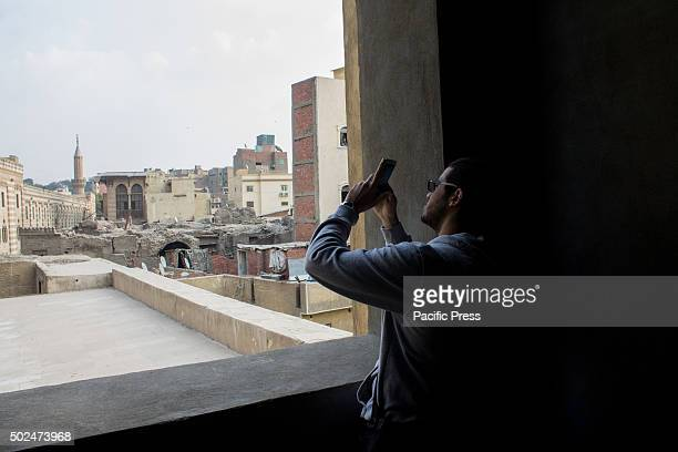 The young Egyptian take pictures from inside a mosque Ali bek Abou El Dahab in Fatimid Cairo Cairo Egypts sprawling capital is set on the Nile River...