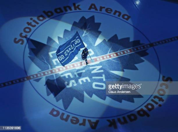 The young flag skater stops at centre ice prior to action between the Tampa Bay Lightning and the Toronto Maple Leafs in an NHL game at Scotiabank...