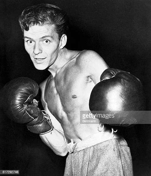 The young Frank Sinatra poses in boxing gloves for a publicity shot. In April of the same year, Sinatra, whose reputation included the occasional...