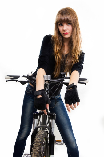 The young girl with bike. 457332777