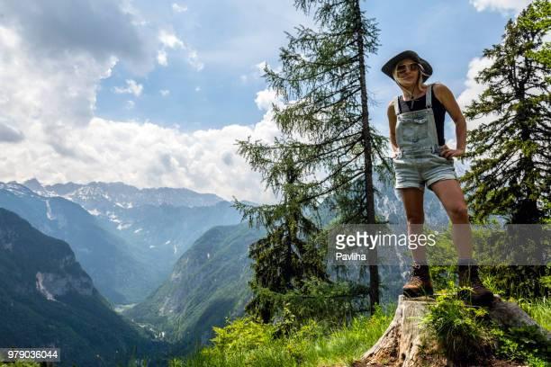 the young hiker enjoys mountain views, the trenta valley, mount jalovec, river soča, primorska,julian alps, slovenia, europe - pavliha stock photos and pictures