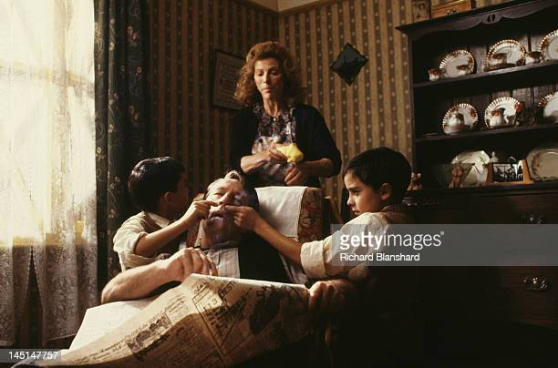 The young Kray twins with their mother Violet and father Charlie senior in a scene from 'The Krays' directed by Peter Medak 1990