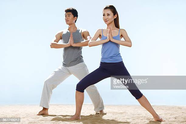 The young lovers do yoga