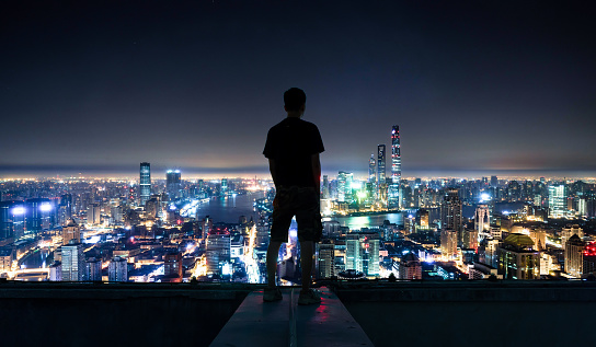 The young man stood on the roof and looked at the shanghai CBD - gettyimageskorea