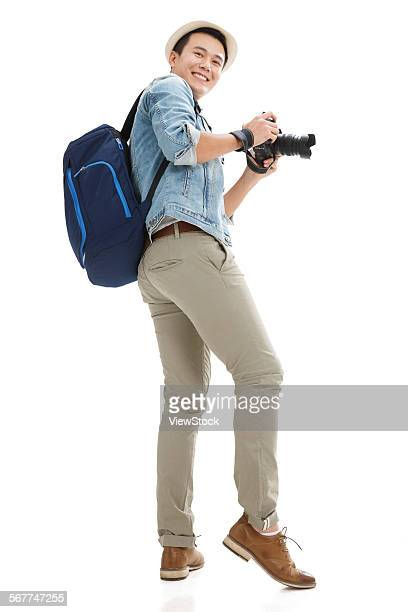 The young man took the camera to travel
