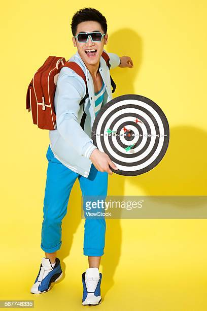 The young man took the circular target