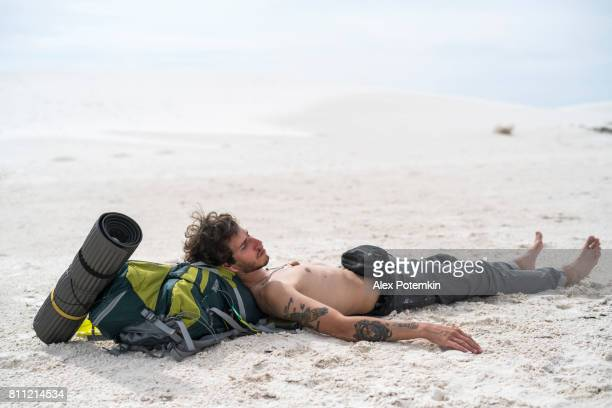 the young man, traveller, backpacker, resting in the white sands national monument, new mexico - greenville south carolina stock photos and pictures