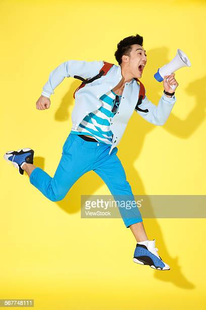 The young man with a loudspeaker shouting