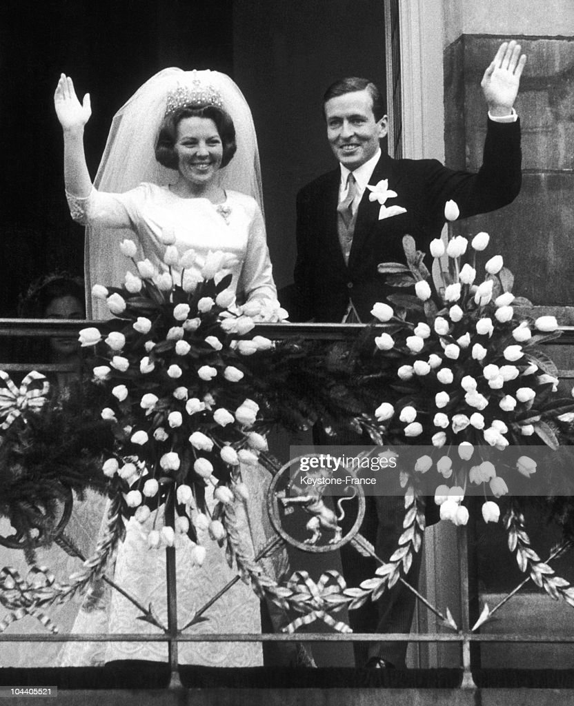 The young married Princess BEATRIX of Holland and Prince Claus VON AMSBERG responding to the cheering of the crowd. The couple came of Amsterdam Royal Palace's balcony after the civilian and religious ceremonies of marriage.