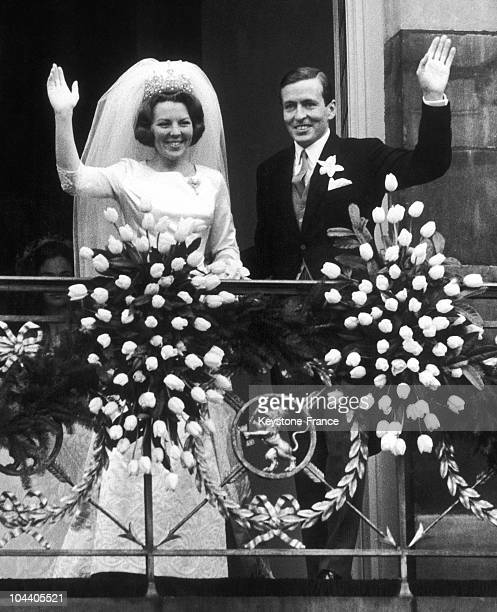 The young married Princess BEATRIX of Holland and Prince Claus VON AMSBERG responding to the cheering of the crowd. The couple came of Amsterdam...