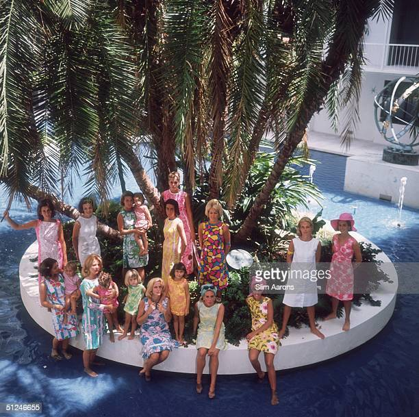 1964 The young matrons of Palm Beach wearing designs by Lilly Pulitzer Wendy Vanderbilt is wearing a yellow dress and pink headscarf Palm Beach...