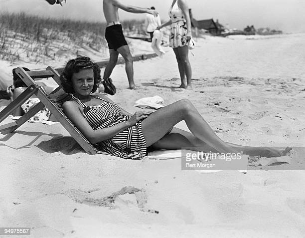 The young Mrs Henry Ford II nee Anne McDonnell lounges on a beach in Southampton New York c1943
