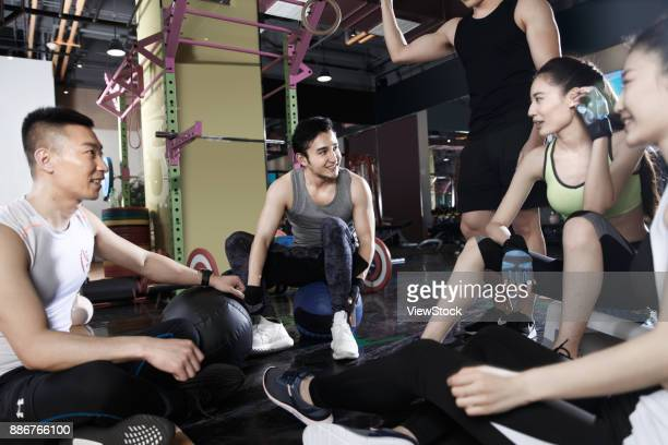 The young people rest in the gym