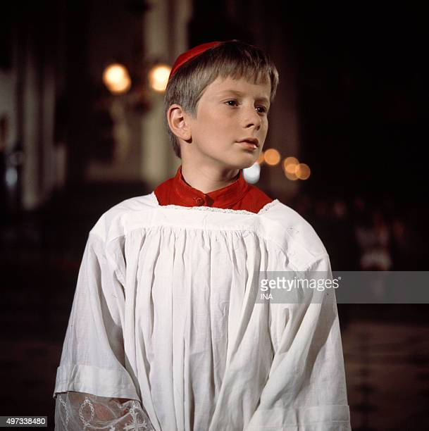 The young person Jean Marc Therin carrying the costume of an altar boy in 'Jean L'Hôte Confessions's television film of an altar boy'