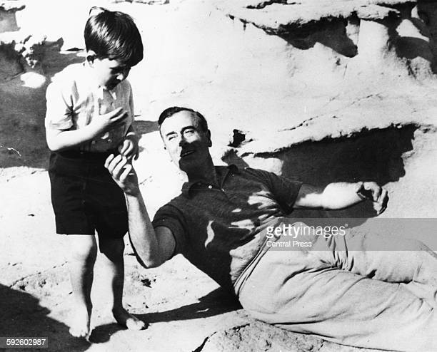 The young Prince Charles playing with his great uncle Lord Louis Mountbatten after landing on the coast of Malta April 27th 1954