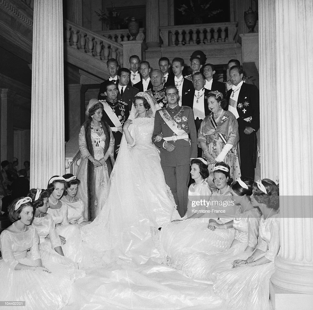 The young royal couple SOPHIE of Greece and Prince Don Juan CARLOS, heir to the Spanish throne, posing with maids of honor and members of the family in Athens. To the right of Princess SOPHIE is Queen FREDERIKA of Greece. To the right of Don Juan CARLOS is the Countess of BARCELONA and behind her, Prince CONSTANTIN, heir to the Greek throne; King PAUL of Greece and the Count of BARCELONA, the father of DON