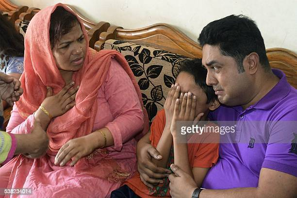 The young son of Mahmuda Aktar the wife of a top Bangladeshi antiterror officer mourns after she was shot dead near her home in Chittagong on June 5...