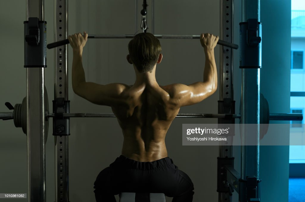 The young sports trainer is muscular workout. : ストックフォト