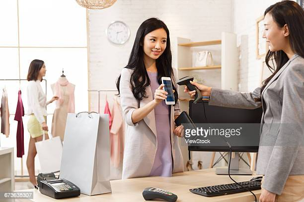 The young woman in the clothing store